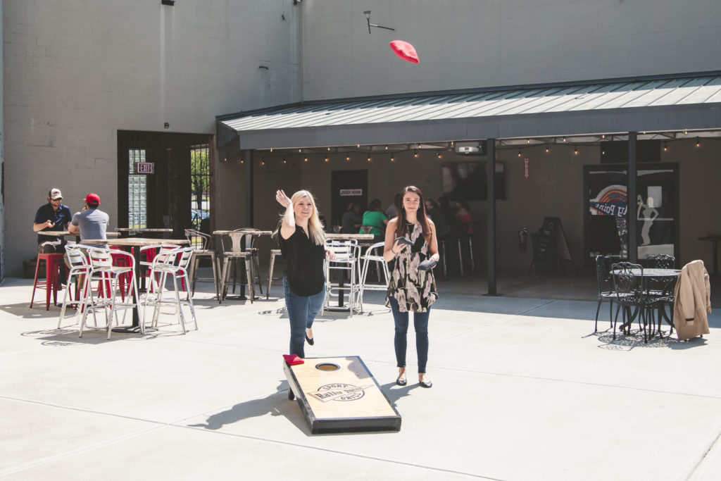 RallyPoint Sport Grill - Cary, NC - Enjoy cornhole on our patio.